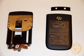 left: the Torch 9800's slider mechanism; right: battery door cover and camera lens cover
