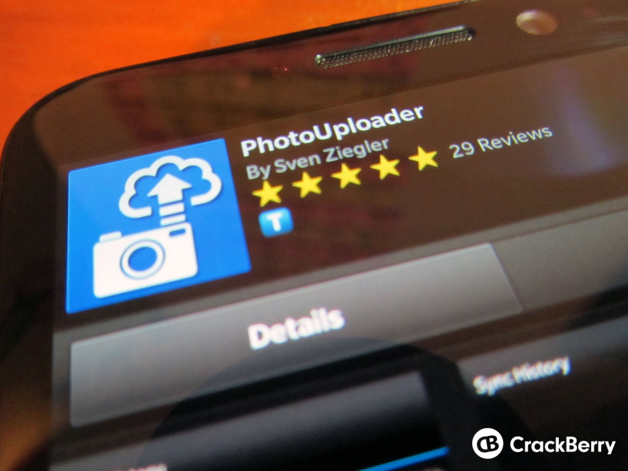 Manually sync photos or set a daily sync time in the latest version of PhotoUploader