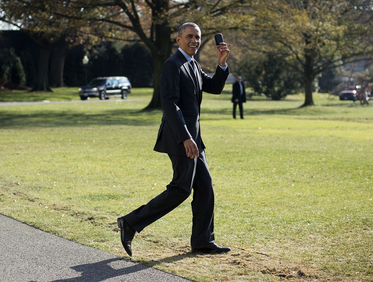 President Obama retrieves his BlackBerry