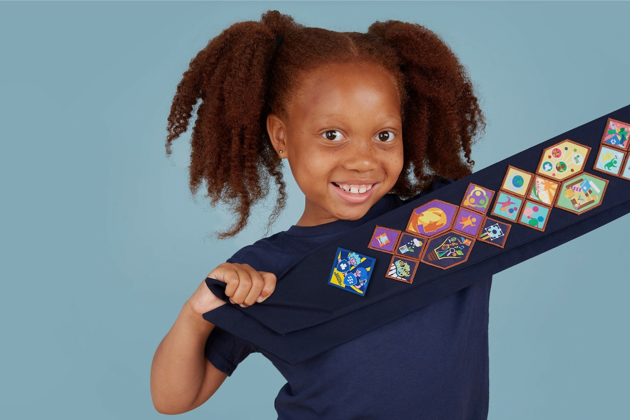 Guide showing off her Girl Guides badges