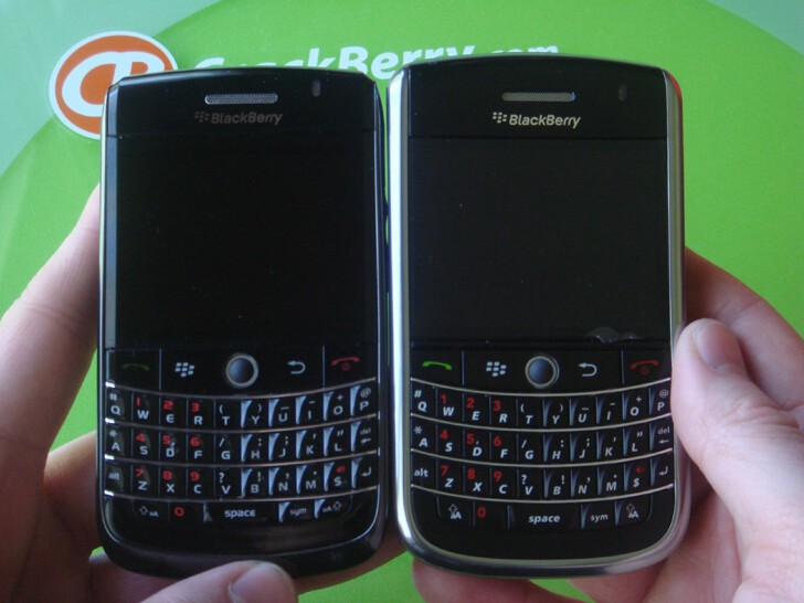 BlackBerry Onyx and BlackBerry Tour 9630 side by side. Onyx has smaller keys on bottom row