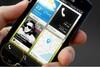 The BlackBerry 10 home screen features widget-like tiles