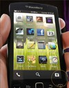 The BlackBerry 10 home screen features familiar icons