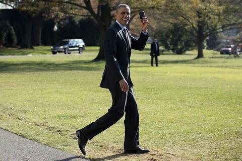 President Obama retrieves his BlackBerry