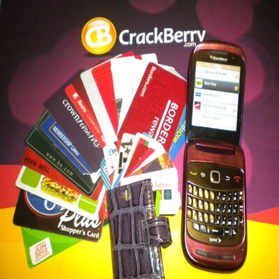 Loyalty cards next to a BlackBerry Style