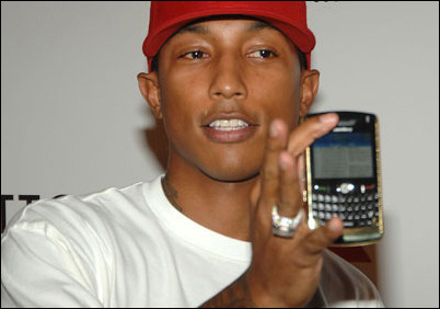Pharrel Williams shows off his Bling