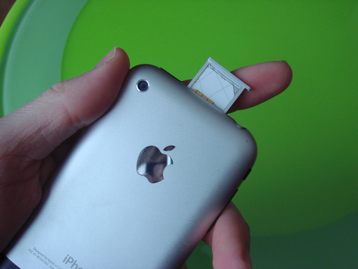 how to open iphone sim card slot with paper clip