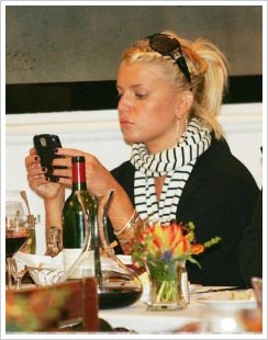 Jessica Simpson playing Sudoku on her BlackBerry
